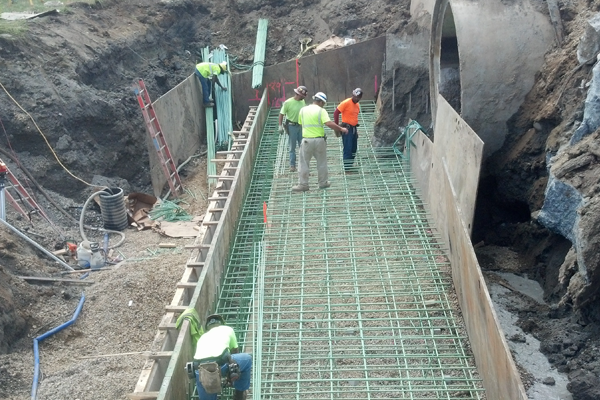 Large scale utility work being performed by Karvo Paving Company's Utility Division